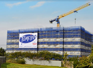 Think outside the box with branded construction site advertising